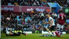 Harry Kane scores his and Tottenham's second in the 2-0 win over Aston Villa at Villa Park. Photograph: Epa