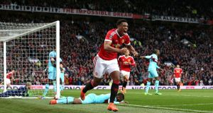 Anthony Martial's equaliser earned Manchester United an FA Cup quarter-final replay with West Ham. Photograph: PA