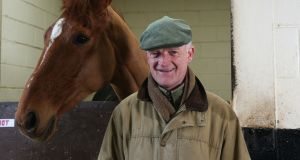 Top trainer Willie Mullins with Champion Hurdle hope Annie Power. Photograph: Brian Lawless/PA