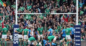 Supporters cheer another Ireland try against Italy at the Aviva Stadium. Photograph: Paul Faith/AFP/Getty Images