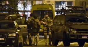 Special operations police take positions during a raid in Brussels . Belgian police launched an anti-terror raid linked to last year's Paris attacks in a Brussels neighborhood on Tuesday. Photograph: Geert Vanden Wijngaert/AP