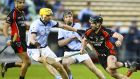 Oulart-The Ballagh's Eoin Moore in action against Na Piarsaigh's David Breen in the semi-finals. Photo: Ken Sutton/Inpho