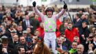 Ruby Walsh celebrates onboard Annie Power after winning the Stan James Champion Hurdle Challenge trophy at Cheltenham yesterday: Photograph: Dylan Martinez/Reuters