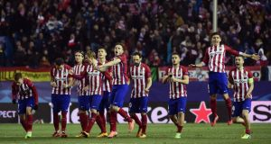 Atletico Madrid players celebrate their shootout win over PSV. Photograph: Afp