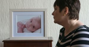 Tina Priestley with  a picture of her son, Bobby, who died at the age of 13 months. Photograph: Dave Meehan/The Irish Times