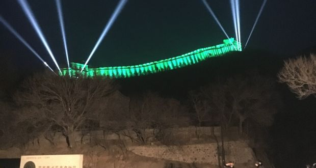 563fca81e7 The ramparts of the Great Wall of China are illuminated in green at  Badaling near the capital Beijing.