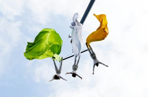 Members of Fidget Feet Aerial Dance Theatre create a tricolour mid-air at the Limerick St Patrick's Day parade. Photograph: Brian Gavin/Press 22