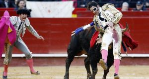 Spanish bullfighter Juan Jose Padilla is hit by his second bull during a bullfight held on the occasion of the Las Fallas festival in Valencia on March 12th. The traditional sport is falling from public favour. Photograph:  Kai  Foersterling/EPA
