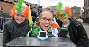 Adam and Joseph Hickey from Kinsealy with Joanne O'Riordan who  led the St Patrick's Day parade through Dublin. Photograph: Alan Betson