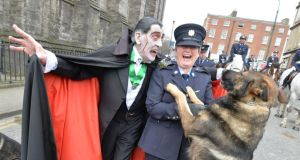 Paddy Drac and Garda Catherine Bartly with Garda Dog Mylo at the St Patrick's Day parade in Dublin. Photograph: Alan Betson