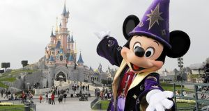 Mickey Mouse in front of the Sleeping Beauty Castle at Disneyland Paris. Photograph: Thomas Samson/AFP/Getty Images