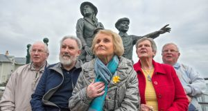 Annie Moore's relatives Noel Brett, Tom Long, Eilish Brett, Lila Long and Frank Brett at her statue in Cobh. Photograph: Michael Mac Sweeney/Provision