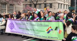 Sinn Féin's Mary Lou McDonald helps hold the banner of the Lavender & Green LGBT Alliance at New York's St Patrick's Day parade as it participates in the event for the first time. Photograph: Simon Carswell/The Irish Times