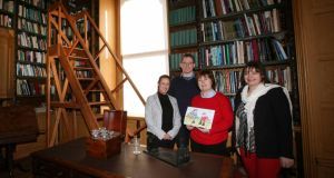 On the up:  Laura Killeen, Noreen Walsh and Teresa Keane of Fighting Words with the assistant keeper of the National Museum of Country Life, where the group holds its classes. Photograph: Brian Farrell