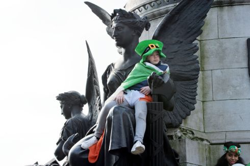 Conor Reilly from Donaghmeade gets the best seat in the house to watch the 2016  St. Patricks Day parade as it winds its way through Dublins main streets. Fine weather and record crowds made the parade  the highlight of the St. Patricks Festival. Photograph: Alan Betson / The Irish Times