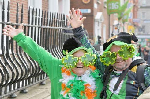 Krystal and AJ Reardon from Virginia USA enjoy the 2016  St. Patricks Day parade as it winds its way through Dublins main streets. Fine weather and record crowds made the parade  the highlight of the St. Patricks Festival. Photograph: Alan Betson / The Irish Times
