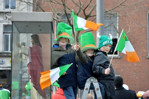 Josh and Tyler Quinn and cousin Reese Nolan from Ballivor enjoying the 2016  St. Patricks Day parade as it winds its way through Dublins main streets. Fine weather and record crowds made the parade  the highlight of the St. Patricks Festival.  Photograph: Alan Betson / The Irish Times