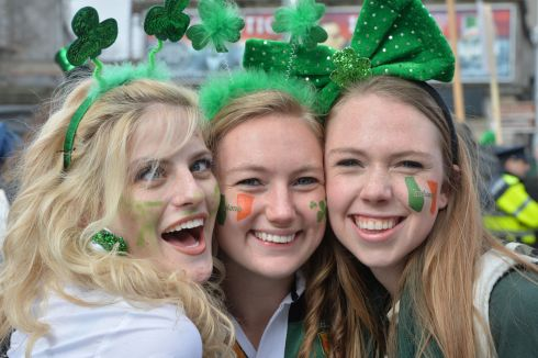 Rosie Kelly, Sally Durand, and Amy Durand from the  USA enjoying the 2016  St. Patricks Day parade as it winds its way through Dublins main streets. Fine weather and record crowds made the parade  the highlight of the St. Patricks Festival.  Photograph: Alan Betson / The Irish Times