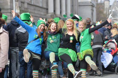Miia Makinen, Svenja Keip, Jana Eirich and Jessica Windhorst from Finland and Germany  enjoy the 2016  St. Patricks Day parade as it winds its way through Dublins main streets. Fine weather and record crowds made the parade  the highlight of the St. Patricks Festival. Photograph: Alan Betson / The Irish Times