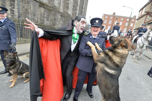 Paddy Drac and Garda Catherine Bartly with Garda Dog Mylo    at the 2016  St. Patricks Day parade as it winds its way through Dublins main streets. Fine weather and record crowds made the parade  the highlight of the St. Patricks Festival. Photograph: Alan Betson / The Irish Times