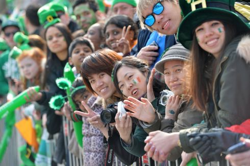 Crowds enjoying the 2016  St. Patricks Day parade as it winds its way through Dublins main streets. Fine weather and record crowds made the parade  the highlight of the St. Patricks Festival. Photograph: Alan Betson / The Irish Times