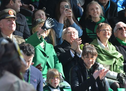 President Higgins and his wife Sabina  enjoying the 2016  St. Patricks Day parade as it winds its way through Dublins main streets. Fine weather and record crowds made the parade  the highlight of the St. Patricks Festival. Photograph: Alan Betson / The Irish Times