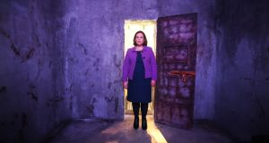 Easter Rising: Mary Lou McDonald of Sinn Féin in a re-created cell at Revolution 1916. Photograph: Leon Farrell/Photocall