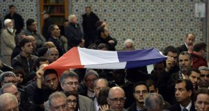 Muslims hold the French flag in the Great Mosque of Strasbourg on November 20th last year to pay tribute to the victims of the  Paris terror attacks. Photograph: Patrick  Hertzog/AFP