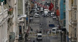 Emergency services inspect the area following a suicide bombing in  central Istanbul. Photograph: Getty