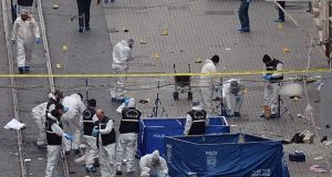 The forensic team at the scene of an explosion, on a street, in Istanbul, Turkey, on Saturday.  Five people have been killed and a number of Irish nationals injured in the blast. Photograph: AP
