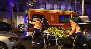 An injured person is rescued  close to Paris's Bataclan concert hall on the night of November 13th, 2015: the attackers, sent by the Islamic State's external operations wing, were well-versed in a range of terrorism tactics such as suicide vests, gunmen in various locations and hostage-taking a report shows. Photograph: Miguel Medinamiguel Medina/AFP/Getty
