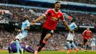Marcus Rashford celebrates after scoring the first goal for Manchester United in their Premier League clash with Manchester City. Photo: Lee Cairnduff/Reuters