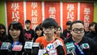 Student protester Joshua Wong (centre), who became the poster boy of the Occupy Central movement, with other members of pro-democracy campaign group Scholarism at a press conference in Hong Kong. Photograph:  Anthony Wallace/AFP/Getty Images