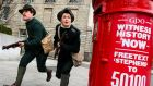 Actors run past a newly repainted  post box as part of an An Post 1916 centenary project. Photograph: Maxwell's