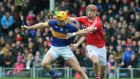 Tipperary's Séamus Callanan and Stephen McDonnell of Cork struggle for possession. Photograph: Lorraine O'Sullivan/Inpho