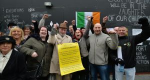The Save Moore Street 2016 campaigners celebrate the High Court verdict designating the street as a national monument. Photograph: Alan Betson