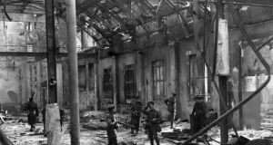 Soldiers inspect the interior of Dublin's General Post Office, viewing the complete destruction of the building after being shelled by the British during the Easter Rising 1916.   (Photo by Hulton Archive/Getty Images)