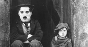 Charlie Chaplin and Jackie Coogan in The Kid: Chaplin was thought to be earning £130,000 a year in 1916. Photograph: AP Photo/File