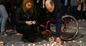 People light candles at the Place de la Bourse following the  attacks on March 22nd, 2016 in Brussels. Photograph:   Carl Court/Getty Images