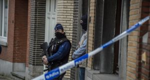 Belgian police secure a house during a police search in Brussels. A raid in the Schaerbeek area turned up a note left by suicide bomber, Brahim El Bakraoui. Photograph: Christophe Petit Tesson/EPA