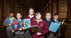 From left, at the launch of the Bookmarks exhibition in Trinity's Long Room were Erik Paul and Clayton Fagan of Drimnagh Castle; Sarah-Ann Mitchell and Caithlain Hanlon of Scoil Cholmcille, Ballybrack; Ryan Loehmann and Finn Wallace of Scoil Eoin, Kilbarrack. Photograph: Paul Sharp/SharpPix