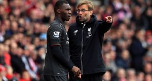 Liverpool manager Jürgen Klopp speaks to Christian Benteke as he prepares to come on during the Premier League defeat to Southampton at St Mary's on Sunday. Photograph: PA.