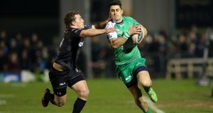 Connacht's Tiernan O'Halloran (right) has been ever-present for Connacht this season in the Pro12. Photograph: Ryan Byrne/Inpho.