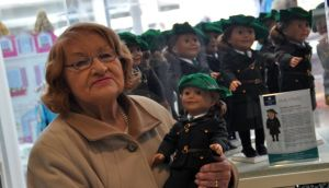 Molly O'Reilly's daughter Constance with a doll of her mother wearing the Irish Citizen Army uniform.