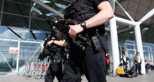 Armed police officers patrol outside the terminal building at London Stansted Airport. Photograph: Chris Radburn/PA Wire