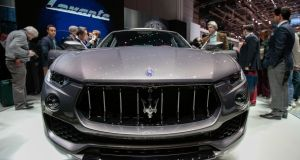 Attendees look at the Maserati Levante on the first day of the 86th Geneva International Motor Show in Geneva, Switzerland.  Photographer: Jason Alden/Bloomberg