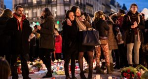 People gather at a memorial  in Brussels  to mourn the dead and injured.  Photograph: AP