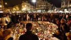 Hundreds of people come together at Place de la Bourse on Wednesday evening to mourn the dead and injured following the Brussels attacks. Photograph: AP