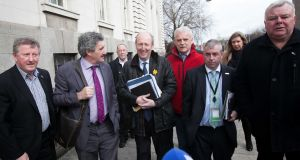 Independent Alliance TDs (left to right) Sean Canney, John Halligan, Shane Ross, Finian McGrath, Kevin 'Boxer' Moran and  Michael Fitzmaurice arrive for talks on the possible formation of a new government with Fine Gael TDs at Government Buildings in Dublin on Thursday. Photograph:   Collins