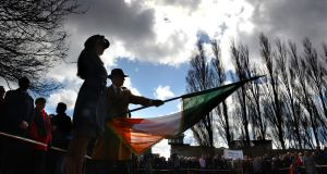 Lowering the Tricolour during the annual Easter Rising 1916 commeremoration at Arbour Hill in 2013. Photograph: Cyril Byrne